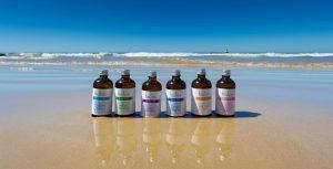 Holos body oils on Algarve beach