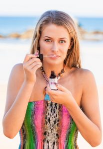 Young woman smelling Holos Anti-ageing Facial oil