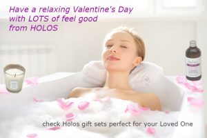 woman having a relaxing bath with rose petals and a few drops of Holos body oil