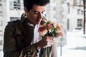 man with bunch of roses