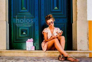 Beautiful girl is enjoying Holos hand cream