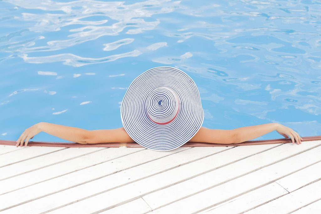 woman relaxing at a pool