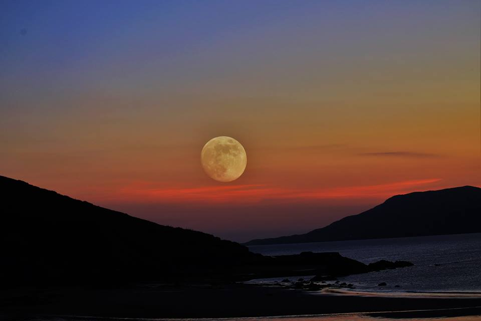 Full moon colorful sky